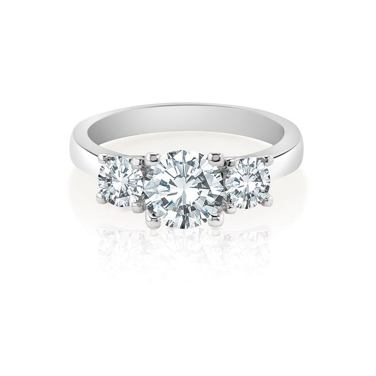 From our classic three stone collection, a shimmering white diamond is set off by a perfectly matched pair of round brilliants.  Starting From $1599