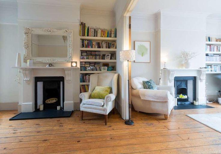 Victorian terrace, antique fireplaces, bookshelves, wooden floorboards, double doors. Interior design. Interior inspiration.