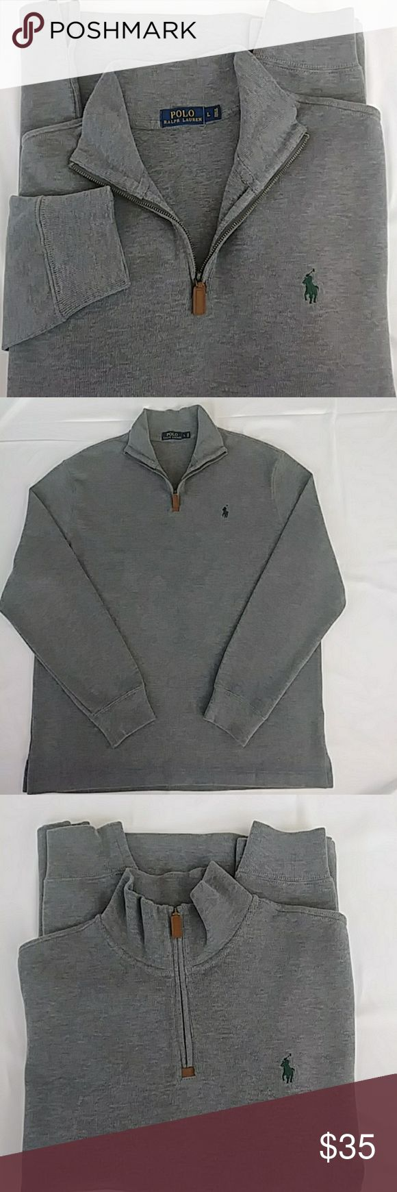Polo Ralph Lauren Men's Half-Zip Sweater Finished with Ralph Lauren's signature embroidered pony, this jersey pullover from Polo Ralph Lauren delivers lightweight warmth with a dose of iconic style. Excellent Condition means: • No pilling • No fading • No stains • No holes, rips, or tears • No bleeding. Ralph Lauren Sweaters Zip Up