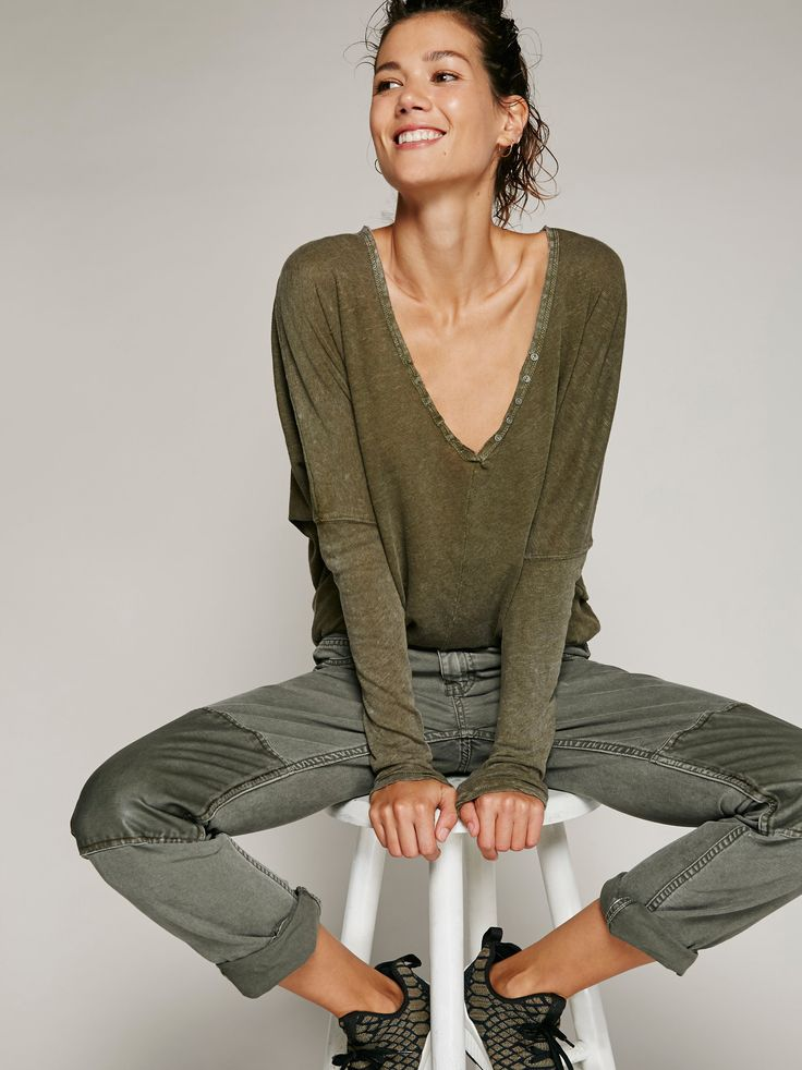 Santa Cruz Henley | Comfortable semi-sheer long sleeve henley tee with super drapey sleeves. Rounded hem creates an effortless shape. Plunging v-neckline with exposed buttons on the subtle placket.