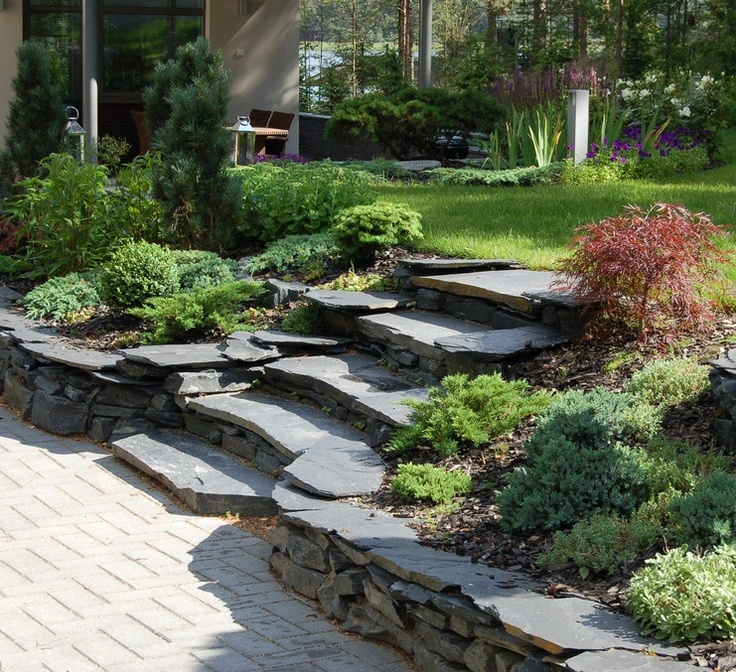 Stone steps in finnish garden. Nice idea for a double-level space. Rustic.