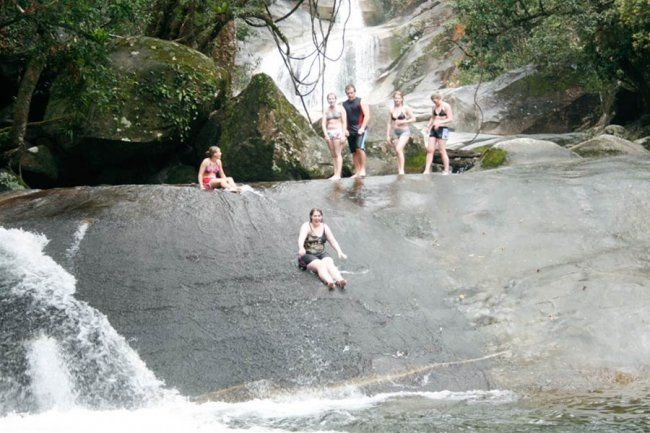 Fun sliding on smooth eroded rocks at Josephine Falls.