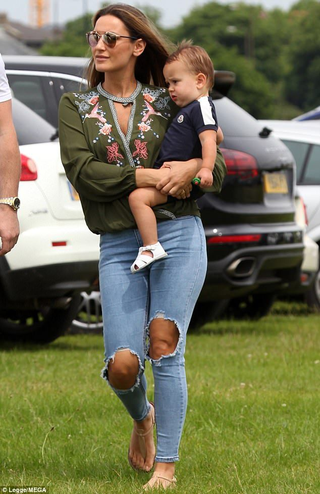 A model mother: Sam Faiers looked every inch the doting mum when she cradled her one-year-old son Paul Tony at the 'In The Night Garden' event live in Greenwich on Monday