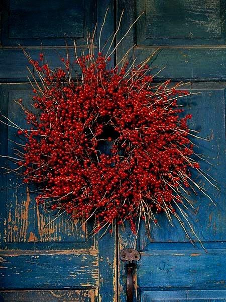 Red wreath on blue door!