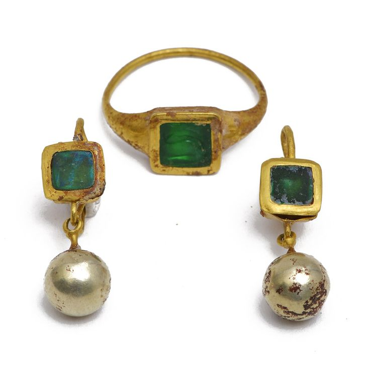 Ring and earrings gold ring set with square and a mint green peridot intaglio and engraved with a fish pendant, also square, are set with glass paste same color as the ring, the below, hanging beads electrum, Roman Egypt,  circa first century, A.D.