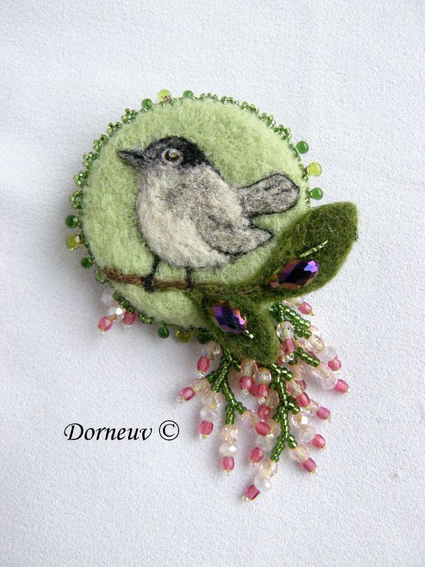 Fauvette 65E felt and bead embroidery brooch. Make it a little bigger and turn it into a little purse.