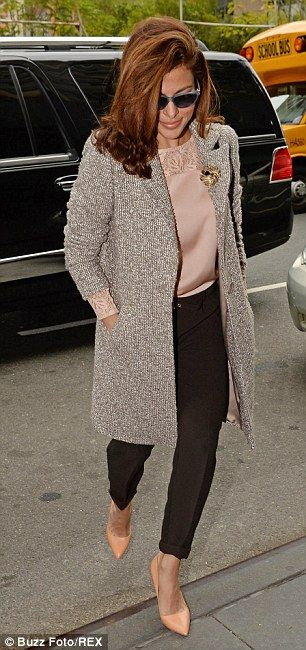 Fashionista: The Hitch actress dressed perfectly for the autumn morning, teaming soft pinks and silver-greys with a pair of sleek black trou...
