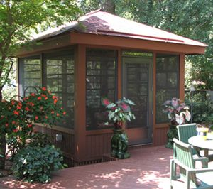 If a larger attached screen porch won't work with your home's layout, how about a smaller, detached screened room?