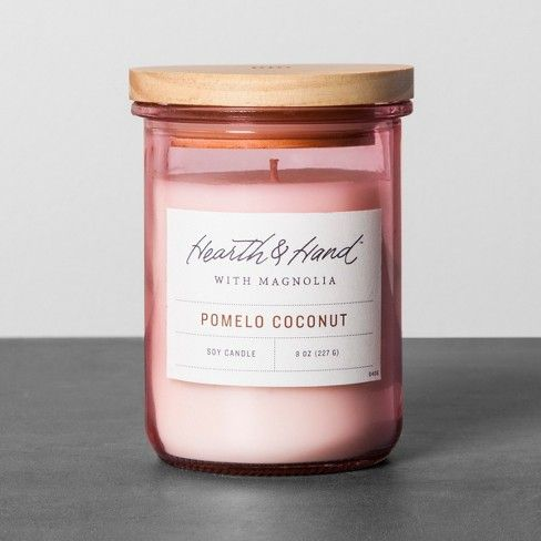 Bring a warm glow and fresh scent to any space with the Pomelo Coconut Lidded Jar Candle from Hearth & Hand™ with Magnolia. The fresh scent of pomelo and other citrus comes together in perfect harmony with the sweet, tropical scent of coconut. When the candle isn't lit, display the beautiful pink glass jar with wooden lid on your shelf or table for a beautiful pop of color. <br><br>Celebrate the everyday with Hearth & Hand — created exclusively for T...