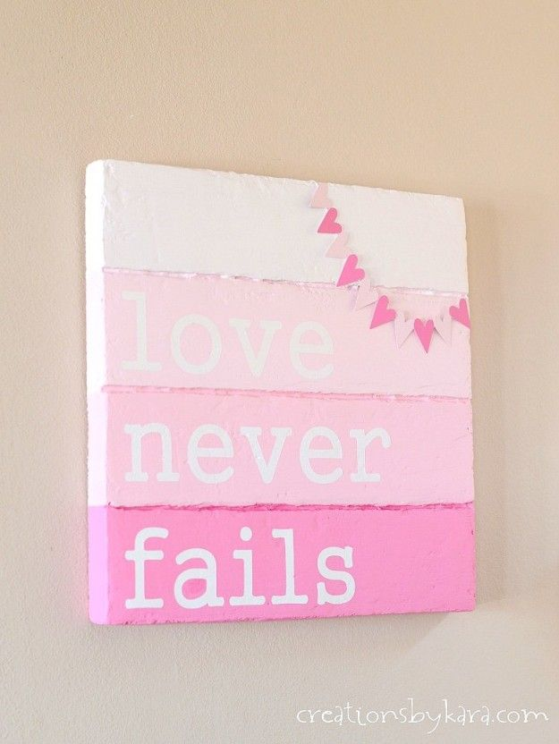 See how I made this Faux Wood Valentines Day Sign- you can do it too!