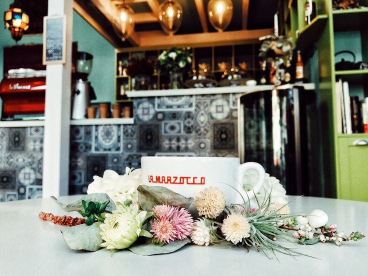 La Marzocco, lovely coffee cup, hugged by flowers.