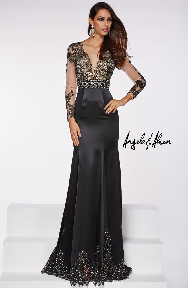Style 51009 Plunge neckline with lace overlay and long sleeves with a satin skirt. Prom, homecoming, formal, pageant and gala's