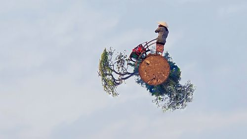 Woman on a tiny planet