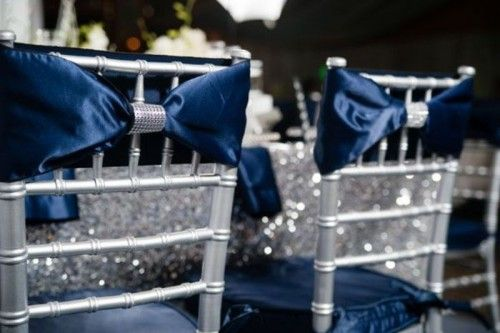 beautiful chair decor  using the midnight  blue bows with an accent of bling and bling table clothes. absolutely wonderful