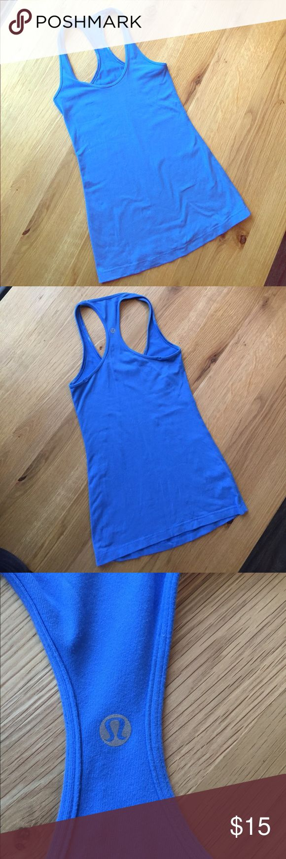 lululemon racertrack blue tank top -Made of light Luon fabric; wicks away sweat and a lot of stretch.   -In decent condition; I'd say say 6.5 out of 10. Some piling, as can be seen in the closeup photos. Blue is more like the one shown on the cover photo.   -I removed the tag (like we all do); it's a size 2. lululemon athletica Tops Tank Tops