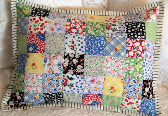This bright and cheery quilted, postage stamp style patchwork pillow cover is done in 1930s reproductions fabrics - mostly by Moda and Windham, and