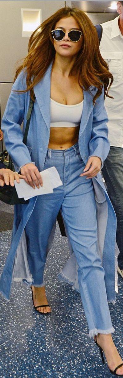 Selena Gomez: Sunglasses – Dior  Coat and jeans – Marques Almeida  Shoes – Jimmy Choo
