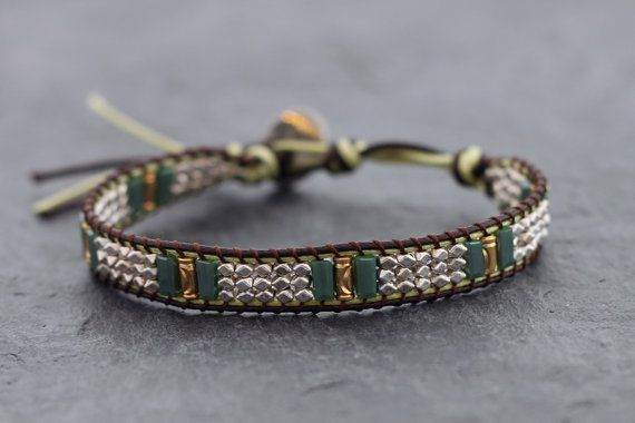 This is hand woven bracelet made with brown and green color polyester waxed cord weaved together with faceted silver plated beads and square cut jade