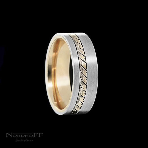 I always find it good fun working with the guys to come up with a unique design that suits their personality.  This wedding ring features a darkened hand engraved rose gold detail, brushed finish platinum and comfortably lined with more rose gold.