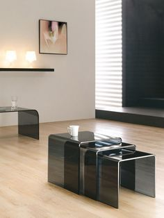 Nesting Design   Nesting black glass coffee tables are a great furniture to achieve a modern atmosphere   #coffeetables modern design #livingroomdesign the living room #moderncoffeetables living room coffee tables   Visit our blog www.coffeeandsidetables.com