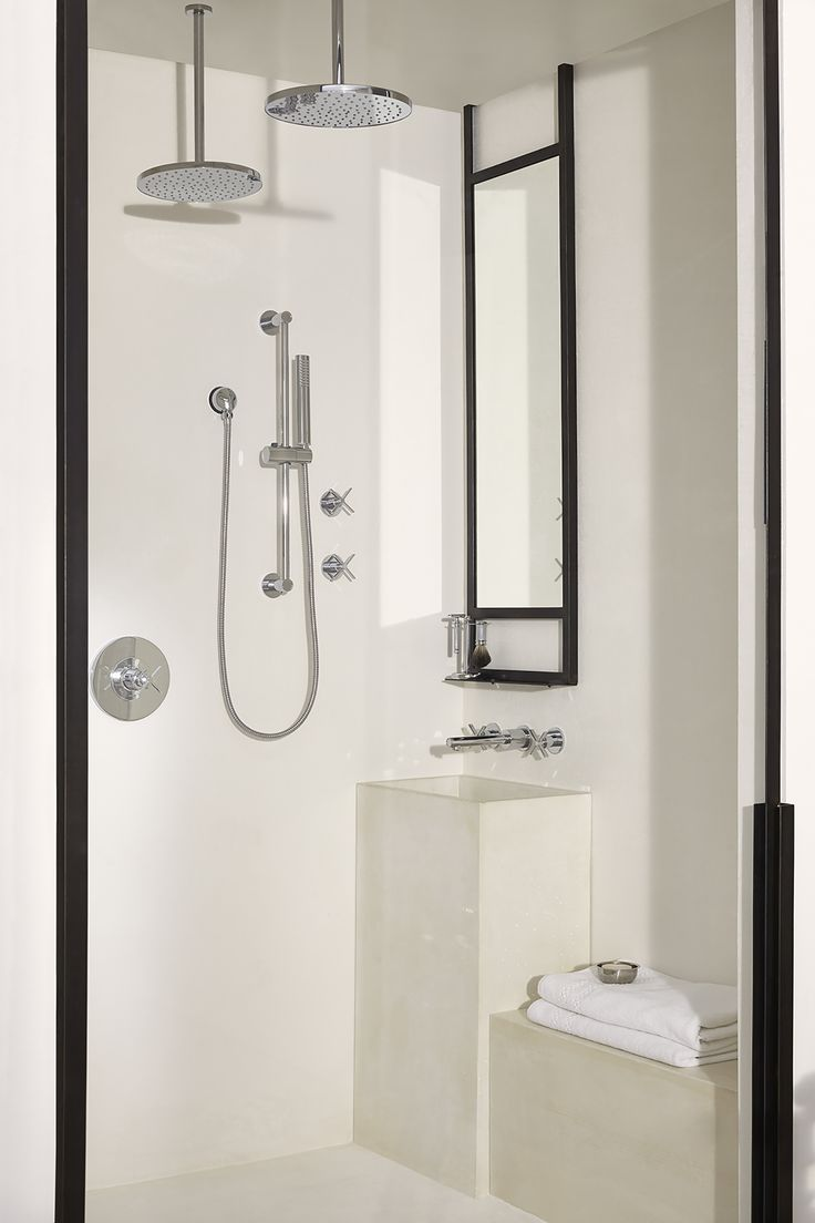 Geneviève Ghaleb's masculine and contemporary #DXVDesignPanel bathroom, influenced by present day Miami, includes a custom concrete shaving space by @910castings with Percy Wall Mounted Vessel Faucet right in the shower.