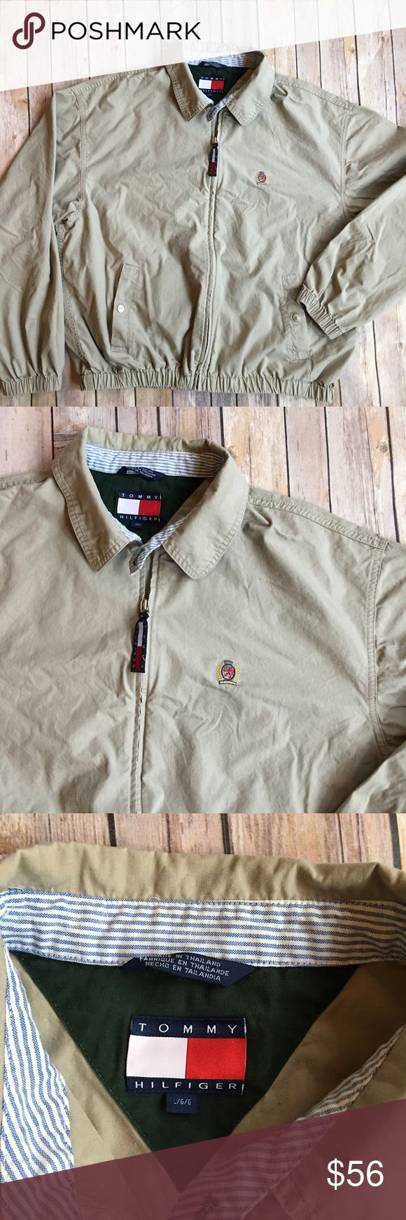 """Vintage Tommy Hilfiger Harrington bomber jacket This 90's vintage jacket is in excellent condition and appears as new. No flaws. 100% cotton. Full zip. 26"""" long and 26"""" from armpit to armpit (measurements taken lying flat). Snap button pockets at hips, Tommy Hilfiger crest at left chest. Tommy Hilfiger logo on back neck, and zipper pull, button collar. Handsome and classic style jacket that's perfect for a light chill or a fashion layer. Tommy Hilfiger Jackets & Coats Lightweight & Shirt…"""