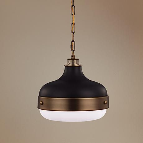 Adorned with a matte black finish and dark antique brass hardware and accents, this mini pendant look is inspired by industrial design.