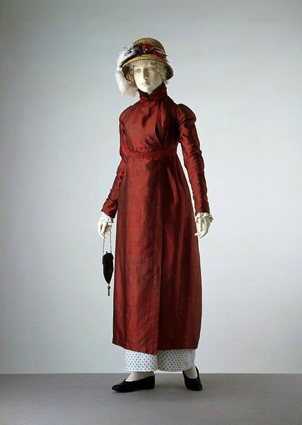 Pelisse of shot red and blue silk ca. 1809 (made) in the Victoria & Albert museum costume collection [Ooh, this looks like it was made during the brief lowered waistline trend that showed up in British fashion plates from roughly 1809-1810, when French fashion was embargoed during the war.]