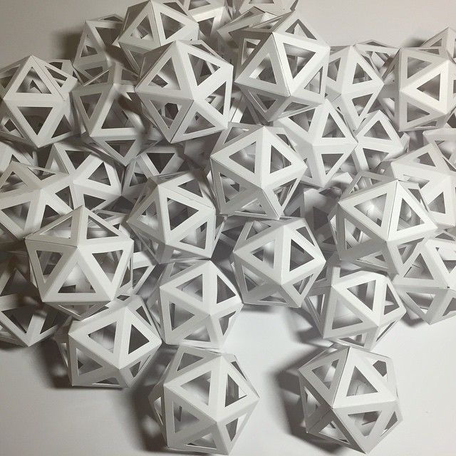 Geometric paper badges lining up for the Faust ball. // Edinas Paper Installations