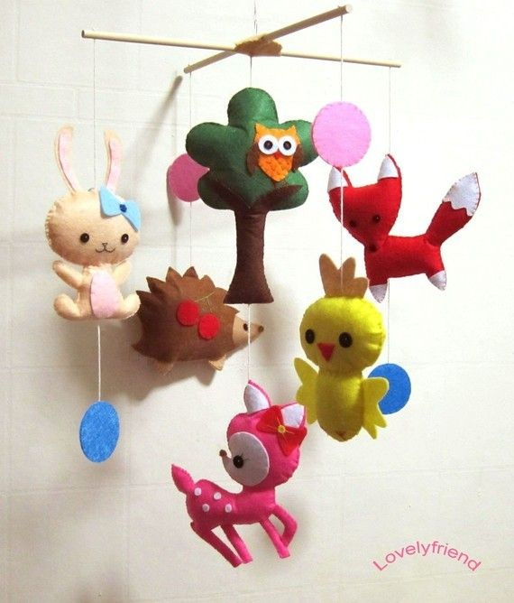 Baby mobile. It goes with my theme and includes a wide variety of colors (I don't want a drowning-in-pink nursery!). Most important for me is the presence of the owl. I also love how the cherries on the hedgehog, the bow on the bunny, and the pink deer give it a feminine feel. $78 #mobile #nursery #forestfriends