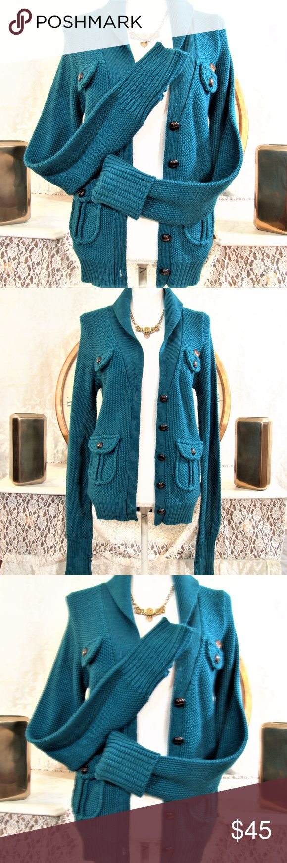 "EZEKIEL Rare SWEATER  Teal tex. knit womens M EZEKIEL (womens, ladies (Extremely Rare Find) TEAL CARDIGAN, SWEATER, W/ TEXTURED Knit fiber, w/ extra long sleeves, allows for CUFFS, WOOD??  or Resin wood BUTTONS. V-neck type LAPEL sweater.  2 pockets w/ buttons (9) buttons total.. Length is 27"" x bust 38"" w FLAT  UN--STRETCHERED. Beautiful Rare sweater, thick/ warm knit.  SIZE (MEDIUM) (M) Garment contents 80% Acrylic & 20% wool, made in India for EZEKIEL Brand. Garment is GREAT/EXCELLENT"