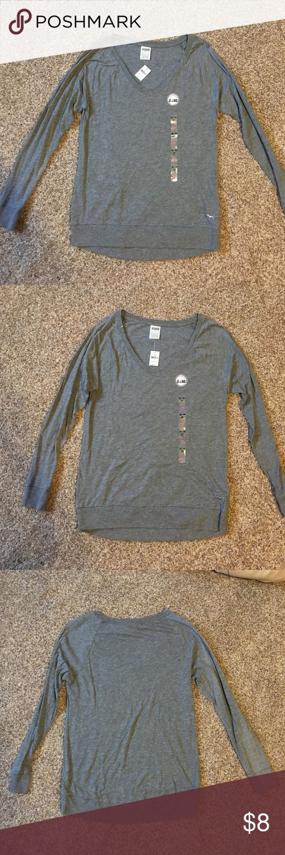 Gray PINK Victoria's Secret Long Sleeve V-Neck T BRAND NEW!! This is a super comfortable long sleeve, v-neck  t-shirt from Victoria's Secret PINK line. The gray shirt is size XS but runs big. Meant to be loose and goes perfect with leggings! Very popular piece of active wear clothing! PINK Victoria's Secret Tops Tees - Long Sleeve