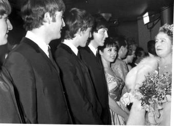 October 26 1965, Queen Elizabeth II invests The Beatles with their MBEs at Buckingham Palace, London. According to an account by John Lennon, the group smoked marijuana in one of the palace bathrooms to calm their nerves.