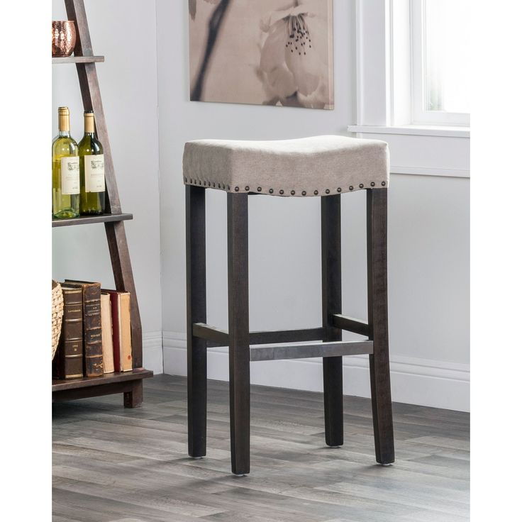 The Kosas Home Kai Backless Bar stool is the perfect addition to any space. The convenient height and well-placed footrest of this glamorous and comfortable stool, allows for the perfect fit for any space.