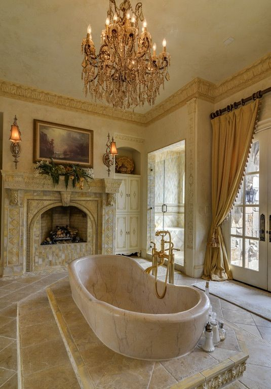 master bath - central step up marble tub Gorgeous walk in shower to the side to the right of the fireplace