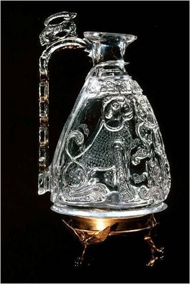 Fig. 135 Rock Crystal ewer made for the Fatimid caliph al-Aziz. 975-976. Rock Crystal. One of the few surviving Fatimid court objects, carved from a single piece of rock crystal. al-Aziz ruled Egypt from 975 to 996. The crystal was imported from Afria and was velieved to prevent nightmares. Many of these precious artifacts were later melted down and sold for their metals. Treasury of St. Mark's, Venice. pg 253.