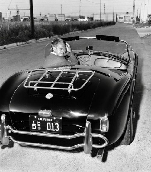 Steve McQueen driving borrowed Shelby Cobra lent to him by Carroll Shelby himself