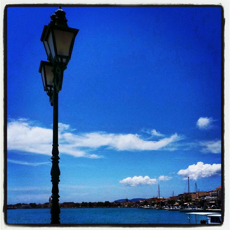 Streetlight against a brilliant blue sky in Zante town..