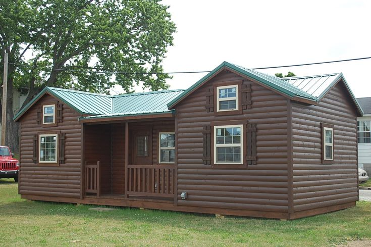 14'x32' Cumberland deluxe cabin walkthrough. 1 br/1 ba/1 loft, kitchen. Options are wall mounted heat/air unit, 2 coats clear coat poly interior, floors stai...