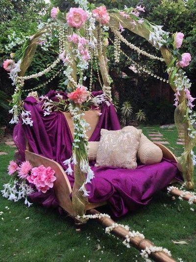 Wedding and Sangeet Decor - Royal Purple Palki with Floral Hangings for Bridal Exit or Enrty   WedMeGood #wedmegood #indianbride #bridalentry #purple #palki #floral