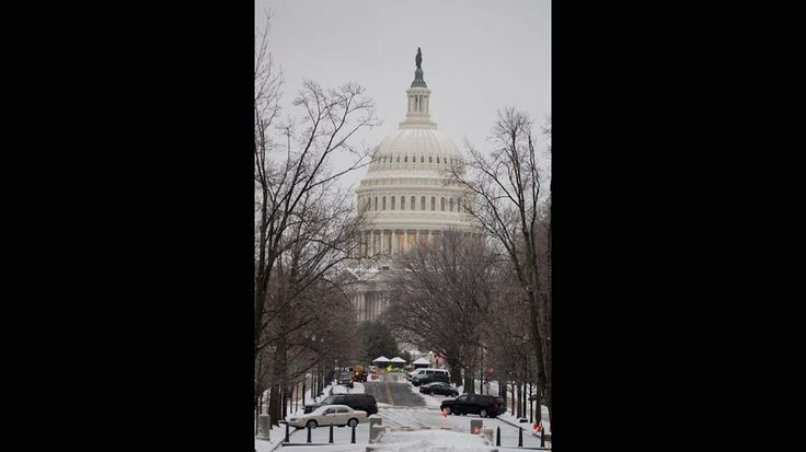 The US Capitol is seen covered in snow in Washington, DC March 14, 2017 Winter Storm Stella dumped snow and sleet Tuesday across the northeastern United States where thousands of flights were canceled and schools closed, but appeared less severe than initially forecast. After daybreak the National Weather Service (NWS) revised down its predicted snow accumulation, saying that the storm had moved across the coast. (Tasos Katopodis/AFP/Getty Images)