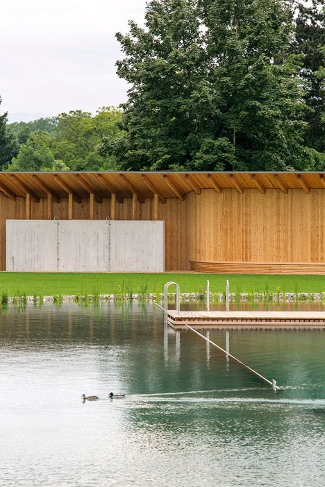 Herzog & de Meuron has completed a biologically filtered bathing lake in Riehen, Switzerland