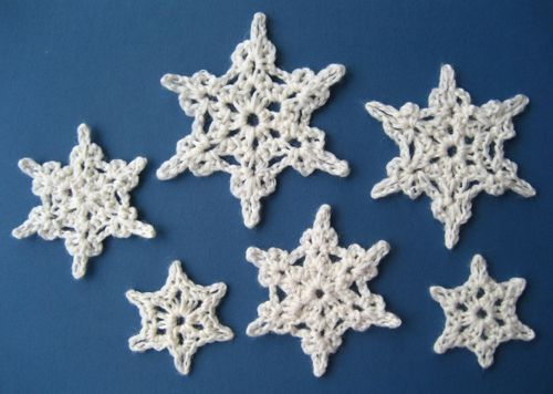 Crocheted snowflakes - I'd love a tree full of these at Christmas. (there is a tutorial, but I don't know the first thing about crochet!)