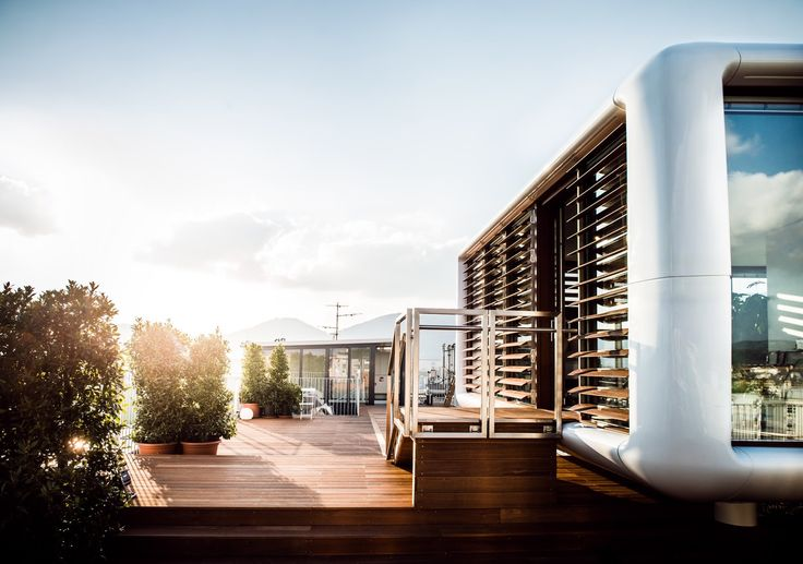 Stay in a Prefab Cube Placed Atop a Midcentury Hotel in Austria - Photo 3 of 8 -