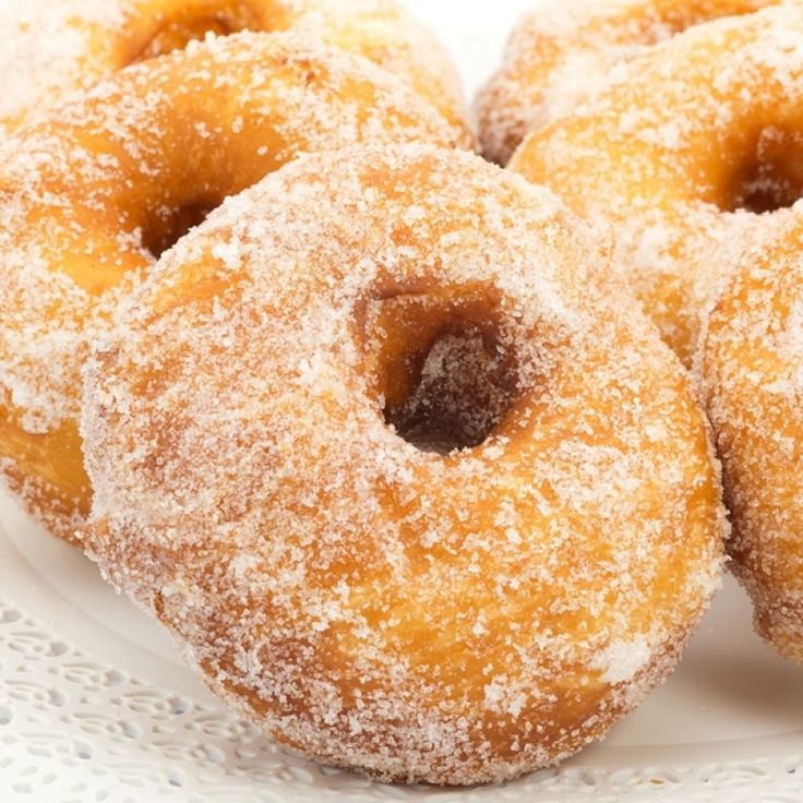 A very yummy recipe for deep fried sugar coated donuts.