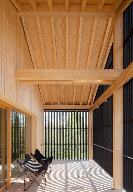 House H by Teemu Hirvilammi has a black exterior and pale wood interior