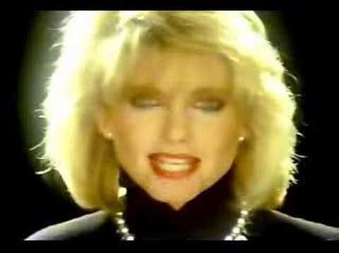 Olivia Newton John - Twist of fate    Just a cheesy 80's movie but I loved this movie and song when I was a kid.....and I gotta say, John Travolta was a hottie back in the day. ;)