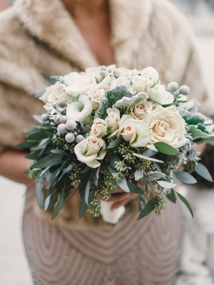 Rose and eucalyptus bouquet Photography: Lauren Fair Photography - www.laurenfairphotography.com/  Read More: http://www.stylemepretty.com/2014/06/17/vintage-hometown-winter-wedding/