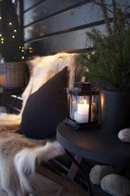 I love the idea of a cozy, outdoor space with comfortable seating draped with warm throws and pillows to help extend the use of your deck in fall or early spring when the weather is cooler. Nice lanterns too. :)