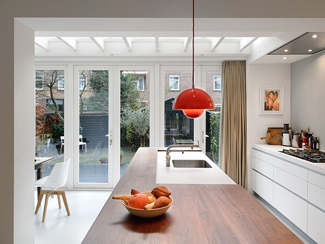 via Bloem en Lemstra Architecten. Indoor kitchen/dining space connected directly with outdoor deck space, through WIDE french doors.